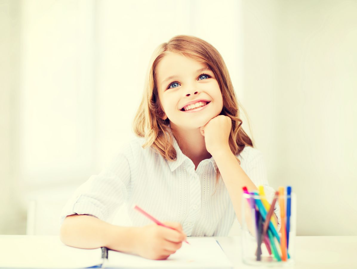 smiling student girl drawing