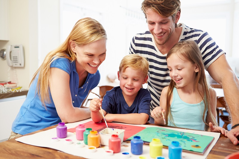 Parents Painting Picture With Children